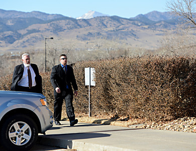 Former Boulder Police Officer Samuel Carter, right, arrives at the Boulder County Jail with his lawyer, Marc Colin, for the filing of charges in the case of the Mapleton Hill elk shooting in Boulder on Thursday, Feb. 7, 2013. For more photos and a video, visit www.DailyCamera.com. (Greg Lindstrom/Times-Call)