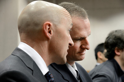 Attorney Patrick Mulligan, left, talks with former Boulder Police officer Brent Curnow during the filing of charges on Thursday, Feb. 7, at the Boulder County Jail. Curnow and Sam Carter are being charged for the killing of an elk on Mapleton Avenue in Boulder. For more photos and video of the filing of charges go to www.dailycamera.com Jeremy Papasso/ Camera