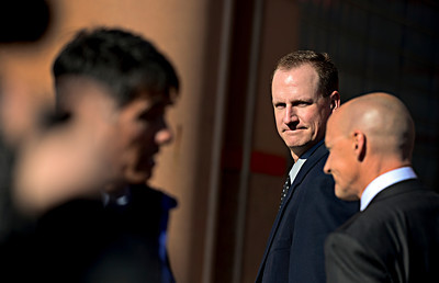 Former Boulder Police Officer Brent Curnow, center, walks out of the Boulder County Jail with his lawyer, Patrick Mulligan, right, after the filing of charges in the case of the Mapleton Hill elk shooting in Boulder on Thursday, Feb. 7, 2013. For more photos and a video, visit www.DailyCamera.com. (Greg Lindstrom/Times-Call)