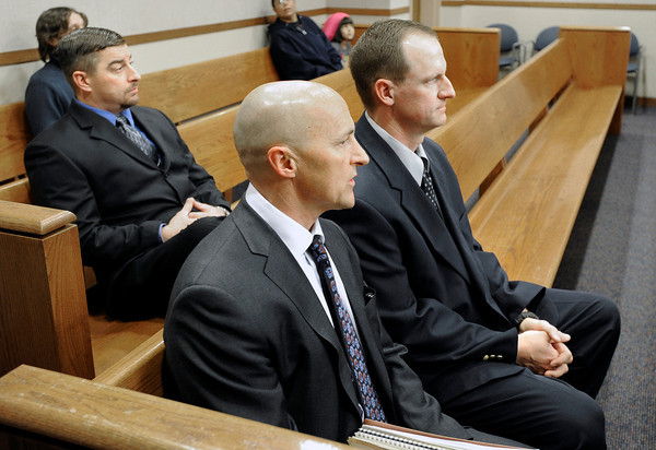 "Attorney Patrick Mulligan, front, sits with former Boulder Police officers Samuel Carter, left, and Brent Curnow, right, during the filing of charges on Thursday, Feb. 7, at the Boulder County Jail. Carter and Curnow, not pictured, are being charged for the killing of a bull elk on Mapelton Avenue in Boulder. For more photos and video of the filing of charges go to  <a href=""http://www.dailycamera.com"">http://www.dailycamera.com</a><br /> Jeremy Papasso/ Camera"