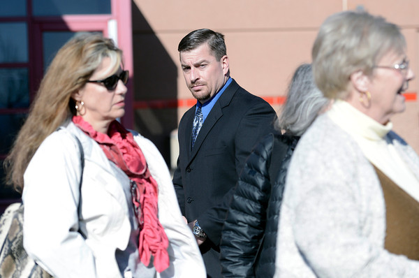 "Former Boulder Police officer Sam Carter, center, walks past Brenda Love Bennett, left, and Rita Anderson,right, after the filing of charges on Thursday, Feb. 7, at the Boulder County Jail. Carter and Brent Curnow, not pictured, are being charged for the killing of a bull elk on Mapelton Avenue in Boulder. For more photos and video of the filing of charges go to  <a href=""http://www.dailycamera.com"">http://www.dailycamera.com</a><br /> Jeremy Papasso/ Camera"