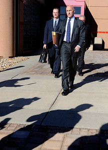 Attorney Patrick Mulligan, front walks with former Boulder Police officer Brent Curnow, left, towards a swarm of reporters after the filing of charges on Thursday, Feb. 7, at the Boulder County Jail. Curnow and Samuel Carter, not pictured, are being charged for the killing of a bull elk on Mapelton Avenue in Boulder. For more photos and video of the filing of charges go to www.dailycamera.com Jeremy Papasso/ Camera