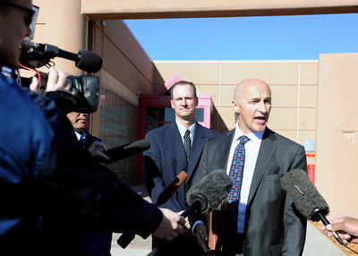 Attorney Patrick Mulligan, right, talks with reporters while standing next to former Boulder Police officer Brent Curnow after the filing of charges on Thursday, Feb. 7, at the Boulder County Jail. Curnow and Samuel Carter, not pictured, are being charged for the killing of a bull elk on Mapelton Avenue in Boulder. For more photos and video of the filing of charges go to www.dailycamera.com Jeremy Papasso/ Camera