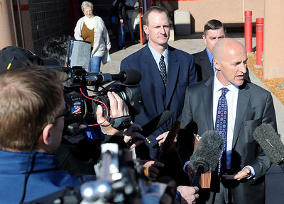 Attorney Patrick Mulligan, right, talks with reporters while standing with former Boulder Police officer Brent Curnow during the filing of charges on Thursday, Feb. 7, at the Boulder County Jail. Curnow and Samuel Carter, not pictured, are being charged for the killing of a bull elk on Mapelton Avenue in Boulder. For more photos and video of the filing of charges go to www.dailycamera.com Jeremy Papasso/ Camera