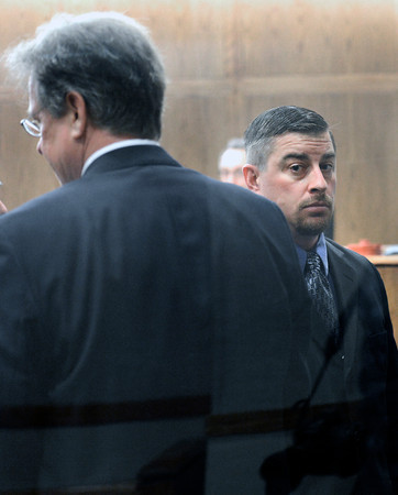 "Former Boulder Police officer Sam Carter, right, walks out of the courtroom during the filing of charges on Thursday, Feb. 7, at the Boulder County Jail. Carter and Brent Curnow, not pictured, are being charged for the killing of a bull elk on Mapelton Avenue in Boulder. For more photos and video of the filing of charges go to  <a href=""http://www.dailycamera.com"">http://www.dailycamera.com</a><br /> Jeremy Papasso/ Camera"