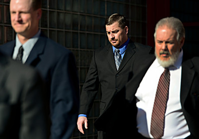Former Boulder Police Officers Brent Curnow, left, and Samuel Carter walk out of the Boulder County Jail with their lawyers after the filing of charges in the case of the Mapleton Hill elk shooting in Boulder on Thursday, Feb. 7, 2013. For more photos and a video, visit www.DailyCamera.com. (Greg Lindstrom/Times-Call)