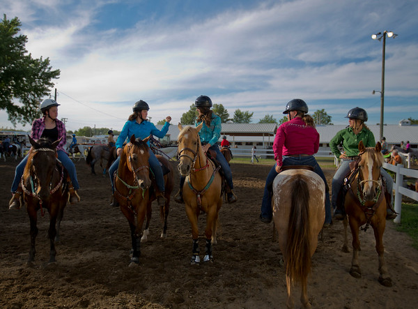 JAY YOUNG | THE GOSHEN NEWS<br /> 4-H Saddle Club members Mariah Miller, 15, second from left, chats with Caylee Cripe, 15, as they wait their turn to compete in a skills event Tuesday evening at the Elkhart County 4-H Fair.