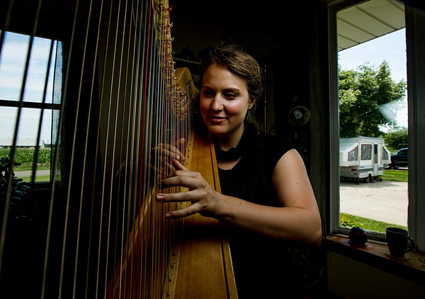 JAY YOUNG | THE GOSHEN NEWS<br /> Harpist Anna Hagen is pictured in her home Wednesday afternoon with one of her five harps.