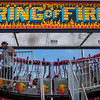 JAY YOUNG | THE GOSHEN NEWS<br /> A carnival worker puts the finishing touches on the Ring of Fire ride Thursday morning at the Elkhart County 4-H Fairgrounds in preparation for the start of the county fair Friday.
