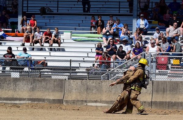 CHRISTINA CLARK | THE GOSHEN NEWS Tate Chapman, of Bourbon Fire Department, finishes strong, carrying 185 pound dummy to the finish.