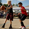 JAY YOUNG | THE GOSHEN NEWS<br /> Eleven-year-old Braxton Wallace, left, looks for a teammate to pass to while Braxton Cline, 9, plays close defense as they compete in the three-on-three basketball tournament Monday evening at the Elkhart County 4-H Fair.