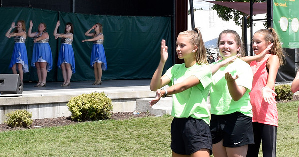 CHRISTINA CLARK | THE GOSHEN NEWS Andrea Garcia and Friends lead La Macarena and encouraged the audience to dance with them. On stage, Ana Dekker, 15, Goshen, Chrissy Hickman, 16, Middlebury, Emily Dell, 17, Middlebury, and Maycie Gibson, 16, Goshen.