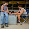 JAY YOUNG | THE GOSHEN NEWS<br /> Jason Yoder, 12, left, and Cory Mast, 16, both of Middlebury, spend time Monday afternoon playing spades at the Elkhart County 4-H Fair.