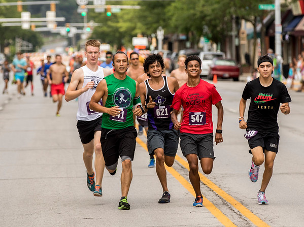 JAY YOUNG | THE GOSHEN NEWS<br /> From left, (612), (641), (621), (547) and (540) run together down the middle of Main Street through downtown Goshen as they compete in the annual Elkhart County 4-H Fair road race Sunday afternoon.
