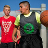 JAY YOUNG | THE GOSHEN NEWS<br /> Ten-year-old Pedro Celis looks over his shoulder at defender Ben Keil, 12, as they compete in the three-on-three basketball tournament Monday evening at the Elkhart County 4-H Fair.