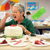 JAY YOUNG | THE GOSHEN NEWS<br /> Surrounded by slices of delicious red velvet cake topped with cream cheese frosting, Elkhart County 4-H Fair Board president Jill Garris samples a slice of cake during the president's baked item contest at the Elkhart County 4-H Fair Thursday afternoon.
