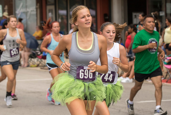 JAY YOUNG | THE GOSHEN NEWS<br /> Some competitors in the annual Elkhart County 4-H Fair road race chose to run in costumes, such as (696) and (744) as they run down Main Street Sunday afternoon.