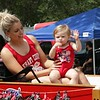 STACEY DIAMOND | THE GOSHEN NEWS<br /> Taylor and Kennedy Lehman, 16 months, of New Paris, being pulled by a Farmall tractor
