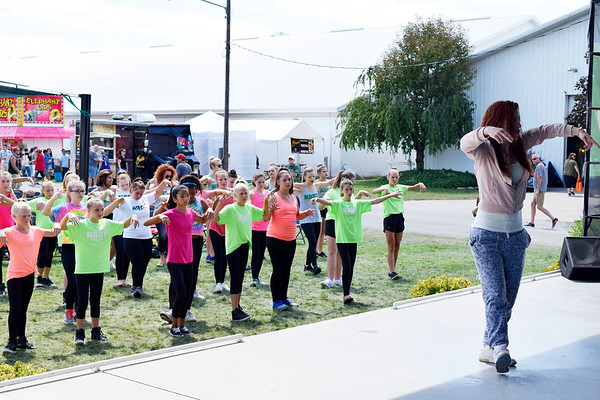 CHRISTINA CLARK   THE GOSHEN NEWS KT Sonfronk, South Bend, leads the National Dance Day routine  instruction for fair participants.