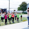 CHRISTINA CLARK | THE GOSHEN NEWS KT Sonfronk, South Bend, leads the National Dance Day routine  instruction for fair participants.