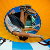 JAY YOUNG | THE GOSHEN NEWS<br /> Nine-year-old Izaiah Cervantes gets turned upside down while racing in a giant inflatable wheel during Kids' Day at the Elkhart County 4-H Fair Wednesday morning.