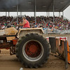 JAY YOUNG | THE GOSHEN NEWS<br /> Scott Short rumbles down the track in his Case 1175 tractor Thursday morning during the tractor pull competition at the Elkhart County 4-H Fair.