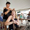 JAY YOUNG | THE GOSHEN NEWS<br /> Fair queen candidate Hannah Myers, of Elkhart, has a laugh while Alicia Yoder, of New Paris fixes her hair before the queen contest Friday evening at the Elkhart County 4-H Fair.