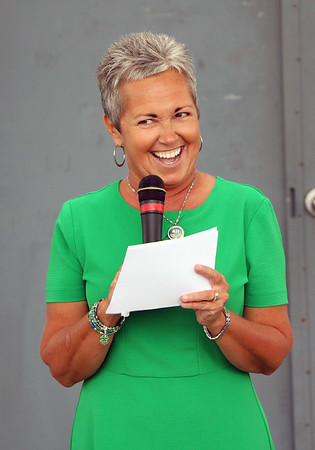 JOHN KLINE   THE GOSHEN NEWS <br /> Fair Board President Jill Garris grins as she gives her welcome address during a ribbon-cutting ceremony early Friday morning officially launching the 2017 Elkhart County 4-H Fair.
