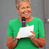 JOHN KLINE | THE GOSHEN NEWS <br /> Fair Board President Jill Garris grins as she gives her welcome address during a ribbon-cutting ceremony early Friday morning officially launching the 2017 Elkhart County 4-H Fair.