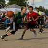 JAY YOUNG | THE GOSHEN NEWS<br /> Ten-year-old Jack Jewell, left, drives past Jethro Hostetler, 12, as they play in the three-on-three basketball tournament Monday evening at the Elkhart County 4-H Fair.