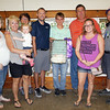 JOHN KLINE | THE GOSHEN NEWS<br /> Grand Champion Commercial Poultry winner Ben Toole, fourth from right, is shown with his winning entry and buyers and supporters, from left, Sarah Kritzman, Lanette Kritzman, Millersburg Clinton Township 4-H Boosters, Emma Kritzman, 2 1/2 months, mother Barb Toole, Mike Blosser, Interra Credit Union, Blake Doriot, Doriot Land Surveying, Maddie Kritzman and Jason Bailey during the Elkhart County 4-H Poultry Auction Friday afternoon.