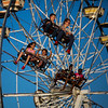 JAY YOUNG | THE GOSHEN NEWS<br /> Riders enjoy the high flying swings Friday evening at the Elkhart County 4-H Fair.