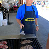 Roger Schneider | The Goshen News<br /> Rick Persing of Nappanee volunteers at the Nappanee Noon Kiwanis food stand at the Elkhart County 4-H Fair. Persing was grilling ribeye steaks Tuesday.