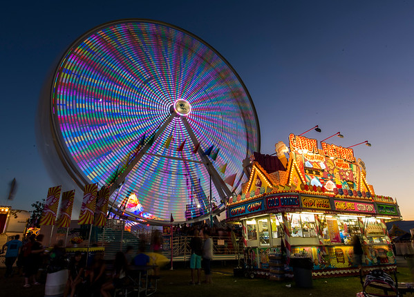 JAY YOUNG | THE GOSHEN NEWS<br /> The Ferris wheel shines bright Friday evening at the Elkhart County 4-H Fair.