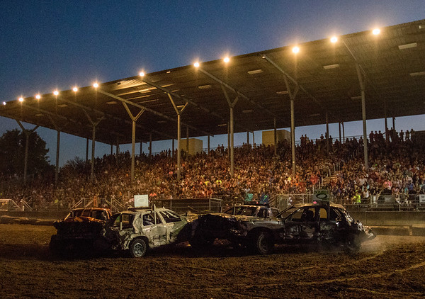 JAY YOUNG | THE GOSHEN NEWS<br /> A group of cars battle it out in the center of the arena at the demolition derby Saturday evening at the Elkhart County 4-H Fair.