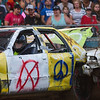 BEN MIKESELL | THE GOSHEN NEWS<br /> Eric Moss, of Goshen, takes a hit during Saturday night's demolition derby at the Elkhart County 4-H Fair.