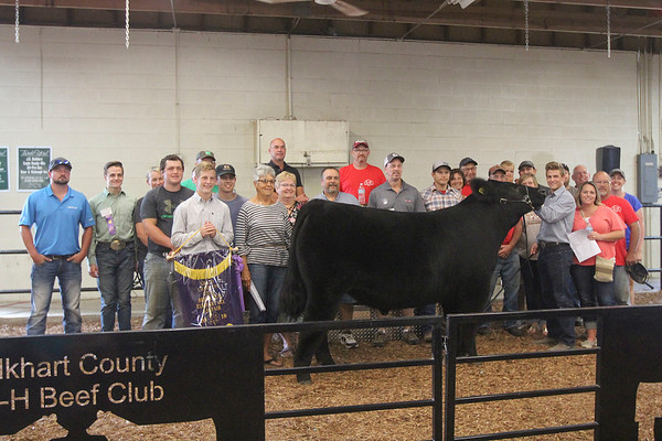 GEOFF LESAR | THE GOSHEN NEWS<br /> Brock Flickinger of Wakarusa, 2018 Elkhart County 4-H Grand Champion Steer Champion Simmental, gathers with supporters following Friday's beef auction.