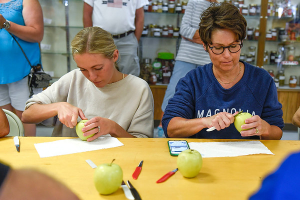 BEN MIKESELL   THE GOSHEN NEWS<br /> Raina Carpenter, left, of Goshen, peels an apple with her mother Karmen Troyer, Goshen, during the apple peel contest Tuesday morning at the Home and Family Arts Building.