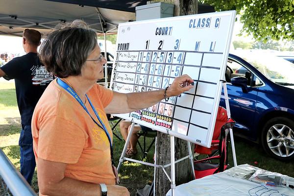 LIZ RIETH | THE GOSHEN NEWS Judy Good, Elkhart County 4-H Fair Horseshoe coordinator, keeps score at the Horseshoe Pitching Contest Wednesday.