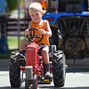 BEN MIKESELL | THE GOSHEN NEWS<br /> Cade Brenneman, 3, of Elkhart, pulls 125 pounds during Thursday's Pedal Power Tractor Pull at the Elkhart County 4-H Fair.