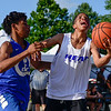 BEN MIKESELL | THE GOSHEN NEWS<br /> Cam'Ron Daniels goes for a layup against Erick Nocentelli during Team Byce's championship game Thursday at the Elkhart County 4-H Fair.
