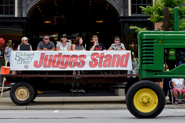 BEN MIKESELL | THE GOSHEN NEWS<br /> Tractors drive past the judges stand during the 2018 4-H Fair Parade Sunday in downtown Goshen.