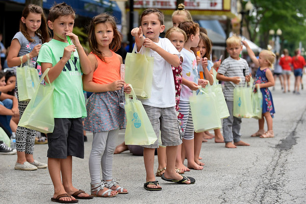 BEN MIKESELL | THE GOSHEN NEWS<br /> Children watch for tractors rolling down Main Street during the 2018 4-H Fair Parade Sunday in downtown Goshen.
