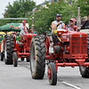 BEN MIKESELL | THE GOSHEN NEWS<br /> Members of the International Harvester Muscle Tractor group make their way down Main Street during the 2018 4-H Fair Parade Sunday in downtown Goshen.