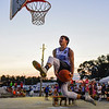 BEN MIKESELL | THE GOSHEN NEWS<br /> Goshen High School graduate Will Line attempts a dunk through-the-legs after the dunk contest Thursday night at the Elkhart County 4-H Fair. Line came in second after missing his final dunk.