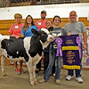 GEOFF LESAR | THE GOSHEN NEWS<br /> <br /> Elkhart County 4-H Dairy Feeder Calf Grand Champion and Heavy Weight Champion Hannah Leatherman, second from right, of Goshen, poses with her calf following the 2018 auction Friday. From left, are Dawn Birr, of Fairland Farm; Shannon Klein, of First State Bank; Tyler Hunter; Hannah's mother Jennifer Leather, of Goshen; and Hannah's father, Eric Leatherman, of Goshen.