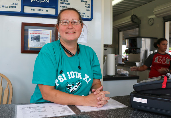 LEANDRA BEABOUT | THE GOSHEN NEWS<br /> Nicole Cross, Goshen, volunteered at the Psi Iota Xi local Goshen chapter Friday afternoon at the Elkhart County 4-H Fair.