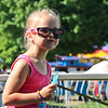LEANDRA BEABOUT | THE GOSHEN NEWS<br /> Eliza Bell, 5, Goshen, enjoys a popcicle in Heritage Park on Kid's Day at the Elkhart County 4-H Fair.