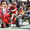 BEN MIKESELL | THE GOSHEN NEWS<br /> Jackson Showalter, 4, of Goshen pulls 125 pounds during Thursday's Pedal Power Tractor Pull at the Elkhart County 4-H Fair.