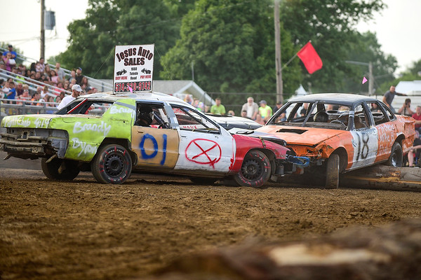 BEN MIKESELL | THE GOSHEN NEWS<br /> Eric Moss, of Goshen, sends Matt Mosely and his vehicle over the wall during Saturday night's demolition derby at the Elkhart County 4-H Fair.